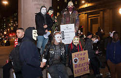 "London, December 23rd 2014. Online activism group Anonymous march through London from the City to the BBC's HQ on Great Portland Street in protest against alleged biases and coverups of a ""paedophile ring"". PICTURED: Protesters observe six minutes' silence for the victims of the Glasgow dustcart accident which happened the previos day."