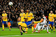 Alex Sandro (12) of Juventus clears the ball with an overhead kick during the Champions League match between Tottenham Hotspur and Juventus FC at Wembley Stadium, London, England on 7 March 2018. Picture by Graham Hunt.