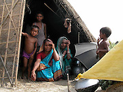 Bewilder village people, take shelter at a safer and higher place - camp at ___________, about 325 kilometers southwest of Gauhati, the capital city of Northeastern Indian state, Assam, Thursday, July 1, 2004. ..Floodwaters of the Asia'a one of the largest river, Brahmaputra and its 35 tributaries have affected more than 2 million in all of South Asia and disrupted communication in many parts of the Indian subcontinent, sources said. (AP Photo/ Shib Shankar Chatterjee).