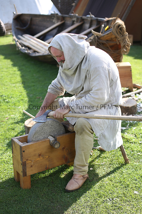 The Vikings of Largs - 'Njal Thorfinnson' a stonemason and fisherman in the village<br /> <br /> The Glasgow Vikings , a re-enactment group who are living on the promenade in Largs for the 750th Commemoration of the Battle against the Scots in 1263. <br /> Members of reenactment groups from around the country join forces to bring history to life. <br /> <br /> Credit: Marc Turner / PFM Pictures