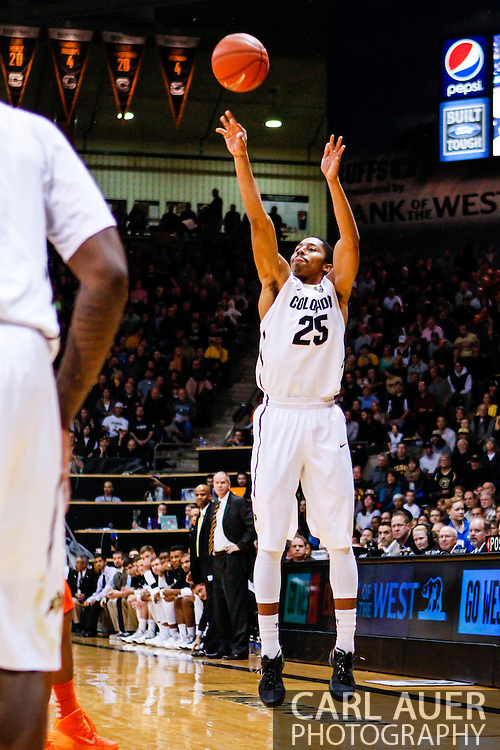 January 2nd, 2014:  Colorado Buffaloes junior guard Spencer Dinwiddie (25) attempts a three point shot in the first half of the NCAA Basketball game between the Oregon State Beavers and the University of Colorado Buffaloes at the Coors Events Center in Boulder, Colorado