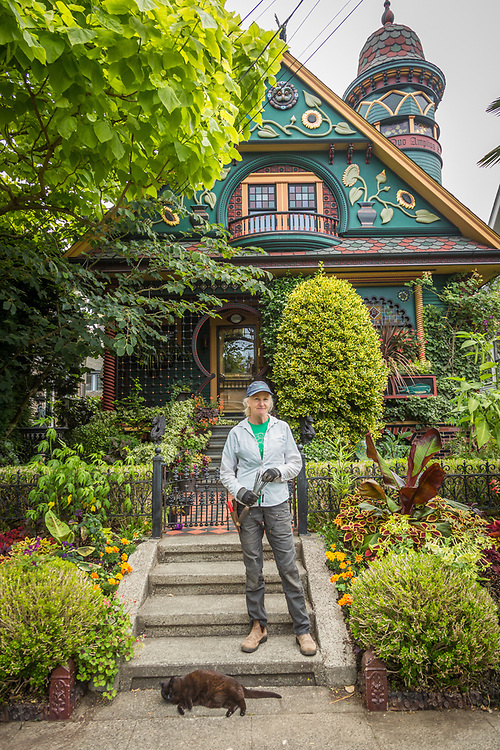 """""""This is a famous Seattle house...I feel honored to work here.""""  -Assistant gardener Patty Schuchart weeds the grounds at the home of Brian Coleman at 2018 Nob Hill Avenue in the Queen Anne neighborhood of Seattle."""