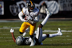 OAKLAND, CA - DECEMBER 09: Wide receiver JuJu Smith-Schuster #19 of the Pittsburgh Steelers breaks a tackle from cornerback Daryl Worley #20 of the Oakland Raiders during the second quarter at O.co Coliseum on December 9, 2018 in Oakland, California. (Photo by Jason O. Watson/Getty Images) *** Local Caption *** JuJu Smith-Schuster; Daryl Worley