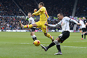 MK Dons forward Jake Forster-Caskey blocks Derby County defender Marcus Olsson's cross during the Sky Bet Championship match between Derby County and Milton Keynes Dons at the iPro Stadium, Derby, England on 13 February 2016. Photo by Jon Hobley.