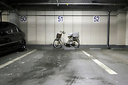 car and bicycle in a parking garage