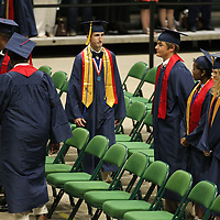 Will Cornelius joins his Nettleton High School classmates for their graduation ceremony Saturday morning at the BancorpSouth Arena in Tupelo.