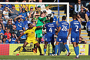 AFC Wimbledon goalkeeper Joe McDonnell (24) saving ball from a cross during the EFL Sky Bet League 1 match between AFC Wimbledon and Oxford United at the Cherry Red Records Stadium, Kingston, England on 29 September 2018.