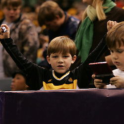 21 December 2008: A young Southern Miss fan in the stands cheers during a 30-27 overtime victory by the Southern Mississippi Golden Eagles over the Troy Trojans in the  R+L Carriers New Orleans Bowl at the New Orleans Superdome in New Orleans, LA.