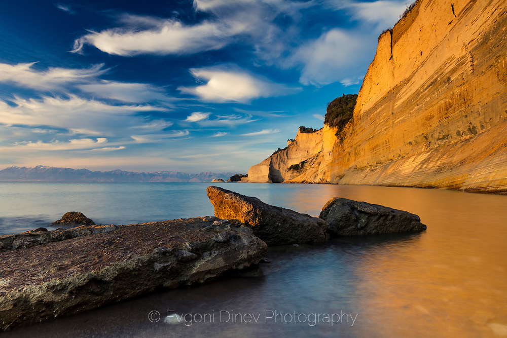 A cliff located on the west side of Corfu island in golden light at sunset
