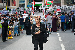 London, July 22nd 2014. Many hundreds of Palestinians and their supporters demonstrate outside the Israeli embassy in London, against the rising death toll in the ongoing ground offensive by Israel in Gaza.