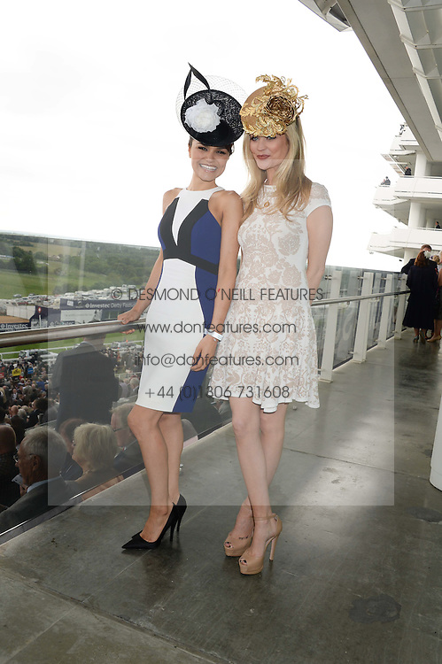Left to right, SAMANTHA BARKS and LAURA WHITMORE at the Investec Derby 2013 held at Epsom Racecourse, Epsom, Surrey on 1st June 2013.