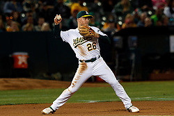 OAKLAND, CA - SEPTEMBER 16: Matt Chapman #26 of the Oakland Athletics throws to second base against the Kansas City Royals during the fifth inning at the RingCentral Coliseum on September 16, 2019 in Oakland, California. The Kansas City Royals defeated the Oakland Athletics 6-5. (Photo by Jason O. Watson/Getty Images) *** Local Caption *** Matt Chapman