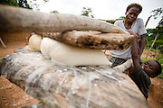 A woman and her child prepare attieke, a local staple made of cassava, in Tano Akakro, Cote d'Ivoire on Saturday June 20, 2009.