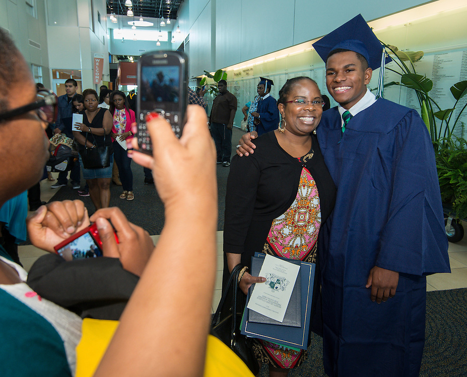 Family members congratulate graduates during the first ever graduation for Mickey Leland College Preparatory Academy, May 27, 2015.