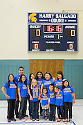 The Salgado family poses for a photo during the Harry Salgado scoreboard dedication ceremony at Sierramont Middle School in San Jose, California, on January 8, 2015. (Stan Olszewski/SOSKIphoto)
