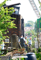 Experts view the damage caused by a fire in the Islamic center, Muswell Hill, London. The fire is reported to be from a far right organisation.<br /> United Kingdom<br /> Wednesday, 5th June 2013<br /> Picture by Max Nash / i-Images