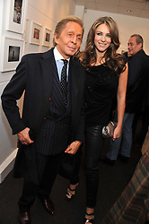 VALENTINO GARAVANI and ELIZABETH HURLEY at a private view of photographs by Anthony Souza held at The Little Black Gallery, 13A Park Walk, London SW10 on 13th December 2011.