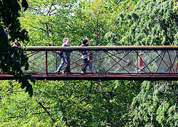 © Licensed to London News Pictures. 31/08/2012. Kew, UK People on the tree top walkway. Visitors enjoy the sunshine on the last meteorogical day of summer at Kew Gardens today 31 August 2012. The summer of 2012 has been one of the wettest on record in Britain. Photo credit : Stephen Simpson/LNP