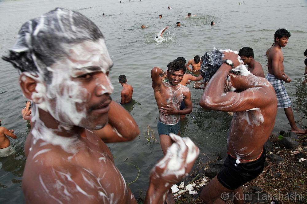 Buddhist pilgrims bathe in the river in Nagpur, Indai, on Oct 14, 15, 2010 during annual celebration of Dr. Ambedkar's conversion to Buddhism from Hinduism. Dr. Ambedkar, an anti-caste activist who was the chief architect of the Indian Constitution, converted to Buddhism in Nagpur along with 380,000 of his followers on October 14, 1956. Tens of thousands Buddhist pilgrims visit Nagpur during the week of celebration.<br /> Photo by Kuni Takahashi