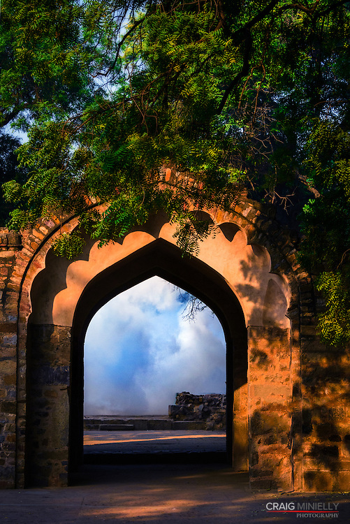 Fog rolls in at sunrise, in the gardens of the Qutb Minar in Delhi, India.<br /> <br /> Nikon D750 90mm  ISO 2500  f11  1/1000s