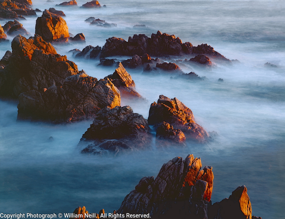 Rock formations and surf at twilight, Big Sur, California  1995