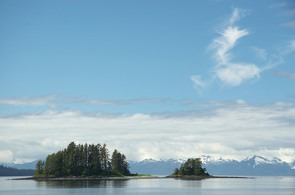 Small island off of Kupreanof Island and Kake with coastal mountains of Tongass National Forest in background. Southeast Alaska. Inside Passage. Summer. Afternoon.