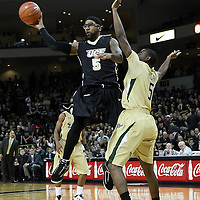 Central Florida guard Marcus Jordan (5) passes the ball against Jawanza Poland  during the NCAA basketball game against the USF Bulls at the UCF Arena on November 18, 2010 in Orlando, Florida. UCF won the game 65-59. (AP Photo/Alex Menendez)