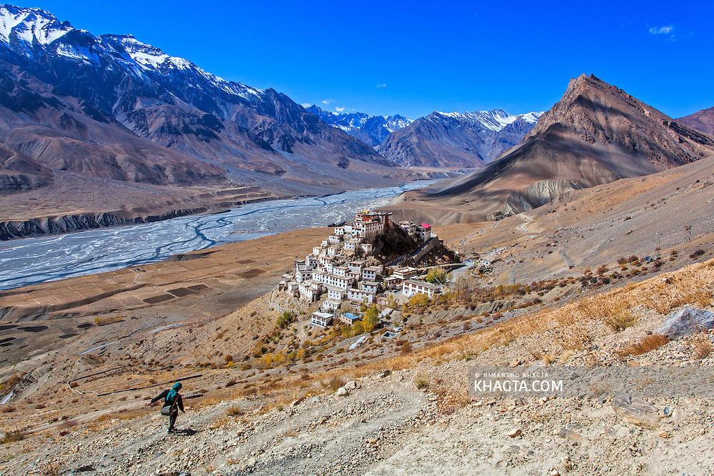 A hiker walks down to Key Monestary in Spiti