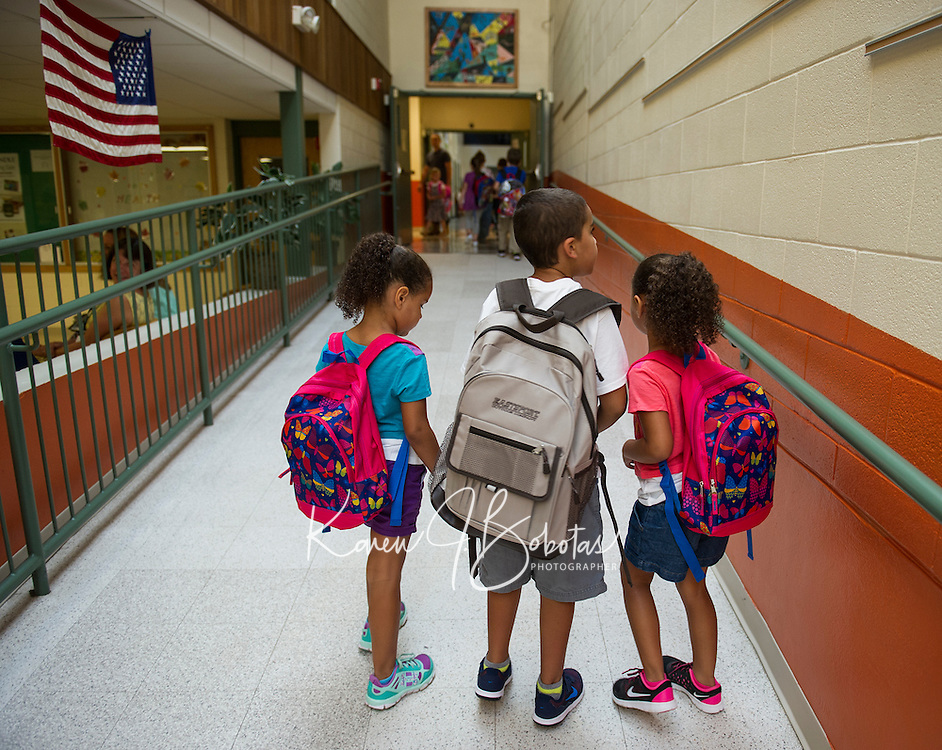 Woodland Heights Elementary students head up the ramp Monday morning to begin their first day of school.  (Karen Bobotas/for the Laconia Daily Sun)