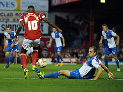 Bristol Rovers' Mark McChrystal tackles Bristol City's Jay Emmanuel-Thomas  - Photo mandatory by-line: Joe Meredith/JMP - Tel: Mobile: 07966 386802 04/09/2013 - SPORT - FOOTBALL -  Ashton Gate - Bristol - Bristol City V Bristol Rovers - Johnstone Paint Trophy - First Round - Bristol Derby
