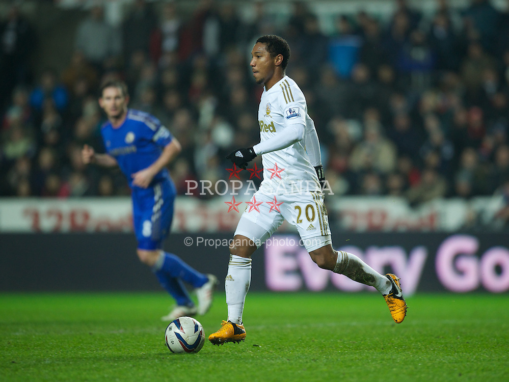 SWANSEA, WALES - Wednesday, January 23, 2013: Swansea City's Jonathan De Guzman in action against Chelsea during the Football League Cup Semi-Final 2nd Leg match at the Liberty Stadium. (Pic by David Rawcliffe/Propaganda)