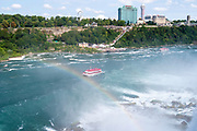 Tourists soak in the mist of Niagara Falls aboard the Maid of the Mist, Buffalo, New York, USA.