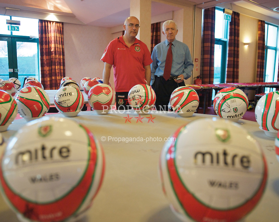 CARDIFF, WALES - Wednesday, March 25, 2009: Wales' press officer Ceri Stennett (L) and Matt Southall organise a signing session for the Wales squad at the Vale of Glamorgan ahead of the 2010 FIFA World Cup Qualifying Group 4 match against Finland. (Pic by David Rawcliffe/Propaganda)