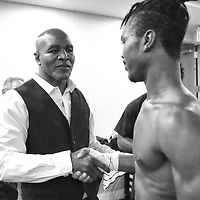 DAYTONA BEACH, FL - FEBRUARY 08: Evander Holyfield shakes hands with his son Evan after he defeats Travis Nero during a boxing match at Hard Rock Hotel Daytona on February 8, 2020 in Daytona Beach, Florida. (Photo by Alex Menendez/Getty Images) *** Local Caption *** Evander Holyfield; Evan Holyfield