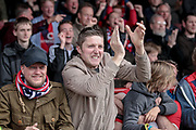 York City fans celebrate as their side score an equaliser during the Vanarama National League match between York City and Forest Green Rovers at Bootham Crescent, York, England on 29 April 2017. Photo by Mark PDoherty.