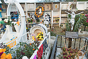 Graves decorated with flowers, balloons and flags in the Nuestra Señora de Guadalupe cemetery during the Day of the Dead festival November 1, 2016 in San Miguel de Allende, Guanajuato, Mexico. The week-long celebration is a time when Mexicans welcome the dead back to earth for a visit and celebrate life.