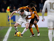 Stuart Dallas of Leeds United shields the ball from Fraizer Campbell of Hull City during the EFL Sky Bet Championship match between Hull City and Leeds United at the KCOM Stadium, Kingston upon Hull, England on 30 January 2018. Photo by Paul Thompson.