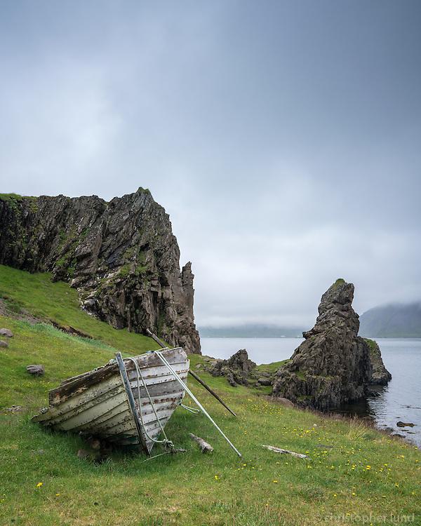 An old boat resting on land in Norðurfjörður, Strandir, Northwest Iceland.