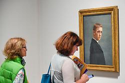 "© Licensed to London News Pictures. 27/06/2019. LONDON, UK. Visitors view ""Self-portrait at the Age of Twenty (Autoportrait à l'âge de vingt ans)"", 1885, by Félix Vallotton. Preview of ""Félix Vallotton:  Painter of Disquiet"", an exhibition of paintings and prints Swiss artist Félix Vallotton at the Royal Academy of Arts.  Around 100 works are on show 30 June to 29 September 2019.   Photo credit: Stephen Chung/LNP"