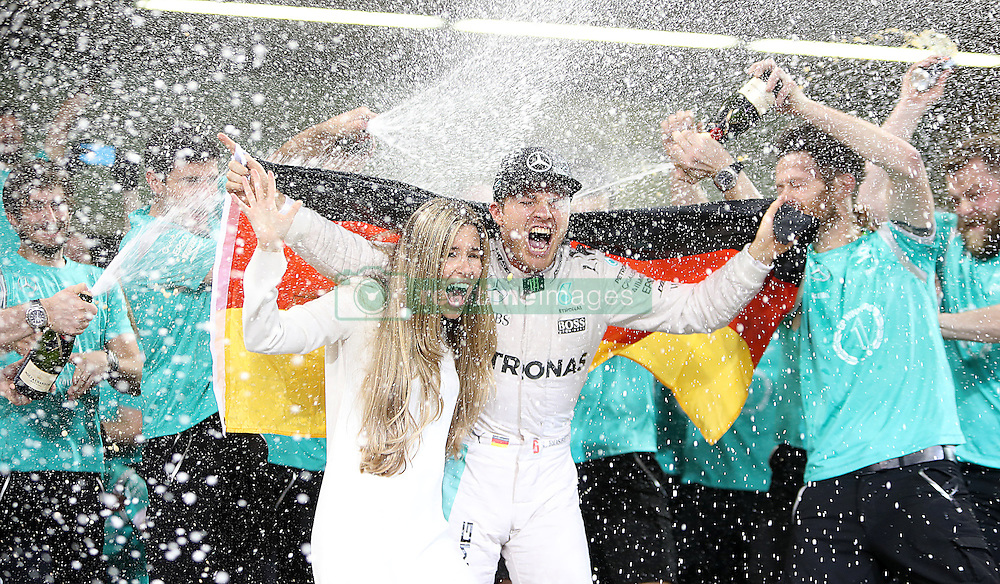 Mercedes' Nico Rosberg celebrates winning the Formula One world championship, with wife Vivian, after the Abu Dhabi Grand Prix at the Yas Marina Circuit, Abu Dhabi.