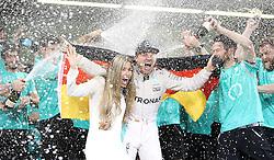 Mercedes' Nico Rosberg celebrates winning the Formula One world championship, with wife Vivian, after the Abu Dhabi Grand Prix at the Yas Marina Circuit, Abu Dhabi.