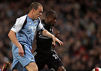 Photo: Paul Thomas.<br /> Manchester City v Chelsea. The Barclays Premiership. 14/03/2007.<br /> <br /> Richard Dunne (L) of City chases Salomon Kalou.