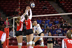 29 October 2011: Shannon McGlaughlin and Tabitha Visk work to block an attack by Megan Bober During a match between the Creighton Bluejays and the Illinois State Redbirds at Redbird Arena in Normal Illinois