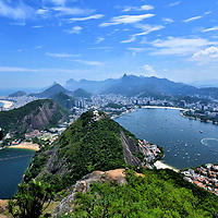 Panoramic View from Sugarloaf Mountain in Rio de Janeiro, Brazil<br /> You have arrived at the summit of Sugarloaf Mountain. Wow! Words fail to describe the panoramic beauty. Within your 360° view are Morro da Urca (center), Vermelha Beach (near left), Copacabana Beach facing the Atlantic Ocean (far left) and Guanabara Bay (right) … all encircling Brazil's prettiest city. No wonder so much of what you see – including where you are standing – has been praised by UNESCO as a World Heritage site. You are now one of the 37 million visitors since 1912 who will remember this day for a lifetime.