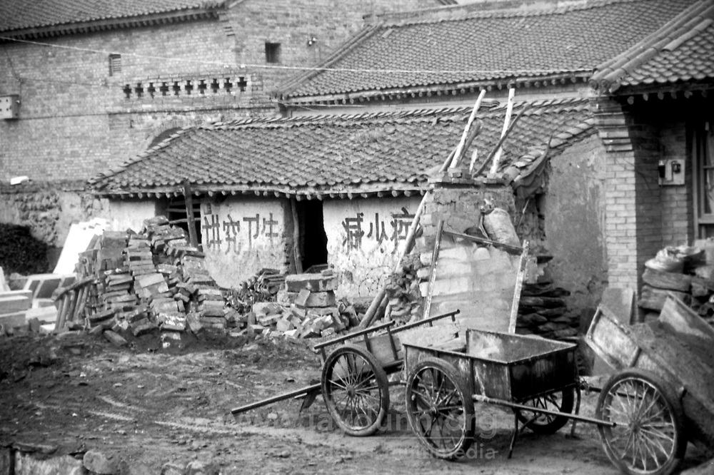 China, Wutai Shan, 2008. Taihuai, in the center of Wutai Shan, balances traditional farm practices with a dedicated local industry. Somewhere in the valley, there is always temple construction or maintenance to be done.