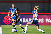 Ji So-Yun (Chelsea) gets the ball away from Ellie Brazil (Brighton) during the FA Women's Super League match between Brighton and Hove Albion Women and Chelsea at The People's Pension Stadium, Crawley, England on 15 September 2019.