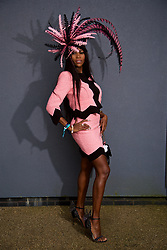 LIVERPOOL, ENGLAND - Thursday, April 6, 2017: Lystra Adams, 40 from Staffordshire, wearing a dress from Moschino, shoes from Sophie Webster, Chanel bag and a fascinator from Sally Sharp in Solihull, during The Opening Day on Day One of the Aintree Grand National Festival 2017 at Aintree Racecourse. (Pic by David Rawcliffe/Propaganda)
