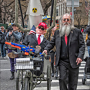 Media prankster Joey Skaggs has created a fake April Fools&rsquo; Day Parade for 31 years, this year, it&rsquo;s April Fools' Day Trump Military Parade.<br /> <br /> The parade began at 5th Avenue and 59th Street at 12 noon, and the procession marched down 5th Avenue, pause at Trump Tower at 56th Street  then continued down to Washington Square Park.<br /> <br /> Skaggs is best known for his  documentary &ldquo;The Art of the Prank.&rdquo;