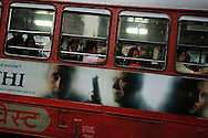 Public bus with advertising for a Bollywood film.
