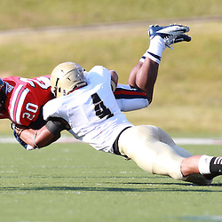Samford D'Morrise Bledsoe is hit by Wofford Alvin Scioneaux  at Seibert Stadium in Homewood, Ala., Saturday, Oct 13, 2012. Samford defeats Wofford 24-17 in Overtime. (Marvin Gentry)